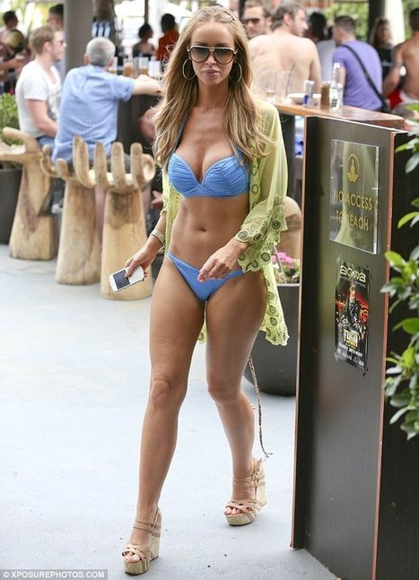 Let the battle of the bikini bodies commence! A confident Lauren Pope struts her stuff in skimpy blue two-piece as she joins TOWIE cast in Marbella | zyxxle | Scoop.it