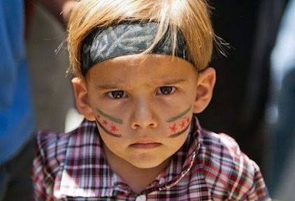 July1: A young Syrian boy with the Syrian reolutionary flag painted on his cheeks | Egyptday1 | Scoop.it