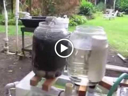 Glenn Martinez and Olomana Gardens demonstrate the double barrel siphon. Google+ | Aquaponics World View | Scoop.it