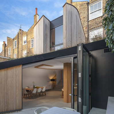 Curvy timber extension by Scott Architects with a sloping grass roof | bureau : espace innovant | Scoop.it
