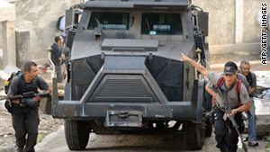 Armored vehicles roll into Rio de Janeiro slum | Brazilian Favelas: The Economic, Political, Social Impact | Scoop.it