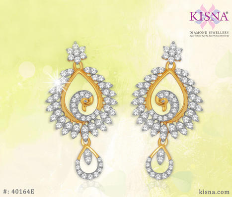Beautiful pair of diamond studded gold earrings designed as a Peacock looks rich in style   Gold Diamond Jewellery Designs   Scoop.it
