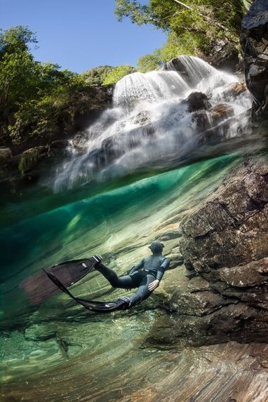 Freediving under the paradise water fall Photo by Marc Henauer -- National Geographic Your Shot | ScubaObsessed | Scoop.it