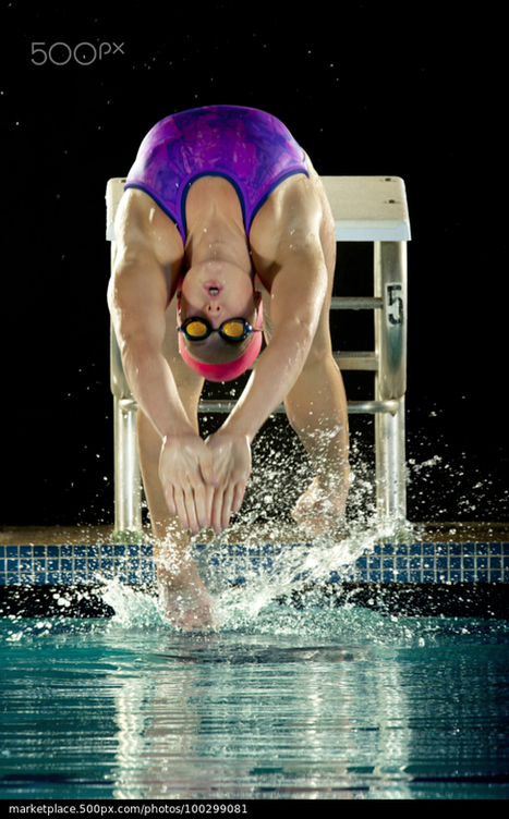 Caucasian swimmer diving off starting block by | 500px Marketplace | My Photo | Scoop.it