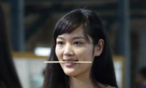 Chinese teenagers urged to smile more by biting down on CHOPSTICKS to practise being nicer to foreigners | Living in China is full of wonder, amazement and absurdities | Scoop.it