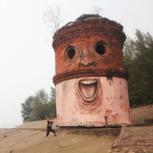 The Living Wall: Russian street artist Nikita Nomerz turns derelict buildings into faces – Telegraph