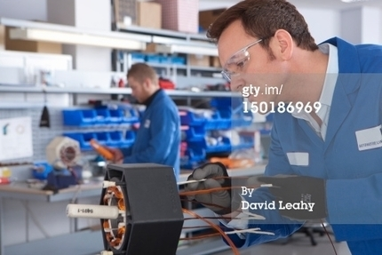 Technician Working With Electric Car Motors High-Res Stock Photography   Getty Images   150186969   Motores Electricos   Scoop.it