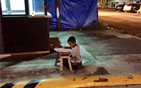 Filipino boy receives scholarship after photograph of him studying on the street goes viral ^ The Telegraph ^ by Flynn Murphy | Scriveners' Trappings | Scoop.it
