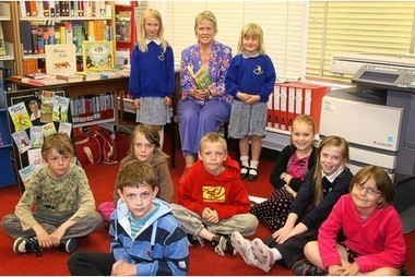 Nathaniel Bridgeman, Georgina Williams and Amelia Wilson get their 100 book track award at Holsworthy Library   Devon Libraries   Scoop.it