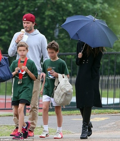 Victoria Beckham shelters under an umbrella as she and David proudly watch Romeo win a medal on school sports day | BlingBling | Scoop.it