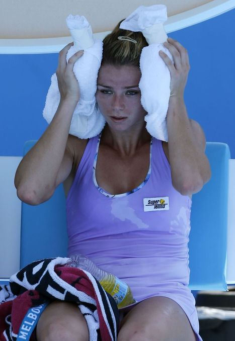Heat wave at Australian Open has players fainting, icing their heads and struggling to play | Tennis and health | Scoop.it