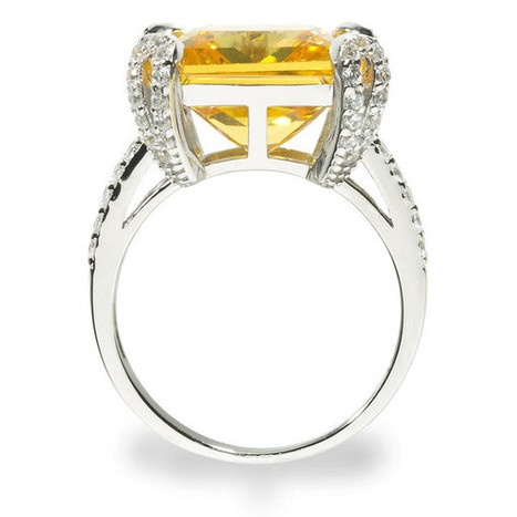 Magnificent Cocktail Ring. Fancy Yellow Center 12.86ct Brillianite. 69 accent Brillianites.   Jewelry Trends   Scoop.it