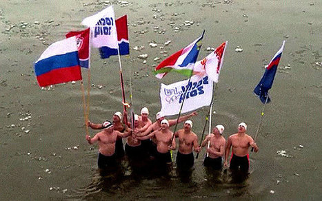 Russian swimmers carry Sochi 2014 Olympic torch through icy river - Telegraph.co.uk | Swimmingly Yours | Scoop.it