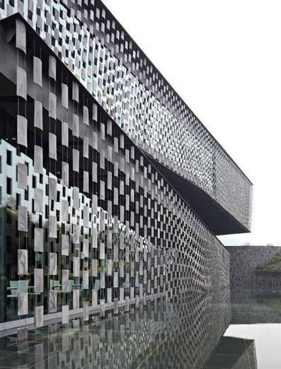 Museum in Xinjin, China, by Japanese architects Kengo Kuma and Associates appears to be screened by rows of floating tiles.   The Architecture of the City   Scoop.it