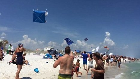 "**XXXTremes ""Oh Hell Yeah news!!""  Blue Angel pilots fly past beach and cause umbrellas to rise into air 