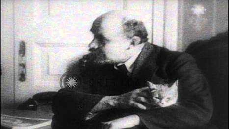 Bolshevik leader Vladimir Lenin sitting at his desk with his cat in his lap, afte...HD Stock Footage - YouTube | Year 12 History Unit 3 | Scoop.it
