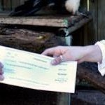 Nikela Volunteer Visits Raptor Center with Donation Check | Wildlife Conservation: People and Stories | Scoop.it