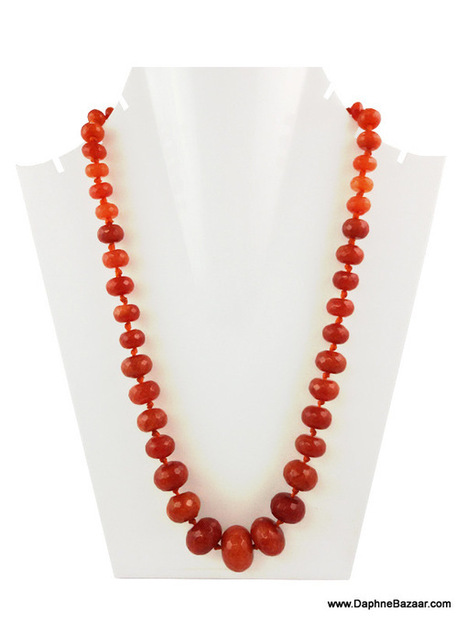 Deep Carrot Orange Shade Oval shaped Beads Neckpiece | Ruby AD Pendant and Earrings | Scoop.it