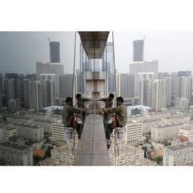 Labourers clean the glass windows outside a 30-floor business building in Qingdao, Shandong province, China, October 4, 2015. A deluge of data from China in coming weeks is likely to point to furth... | What Fascinates Me About China | Scoop.it