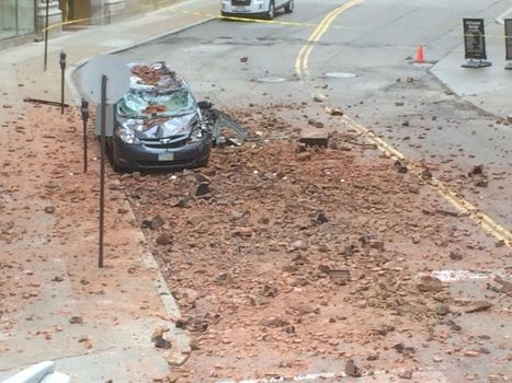 """Bricks fall from downtown Cleveland building, smashing minivan and closing block (photos, videos) 