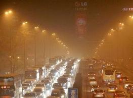 """Beijing to restrict car sales further to reduce pollution - Economic Times (""""less cars = less pollute"""") 
