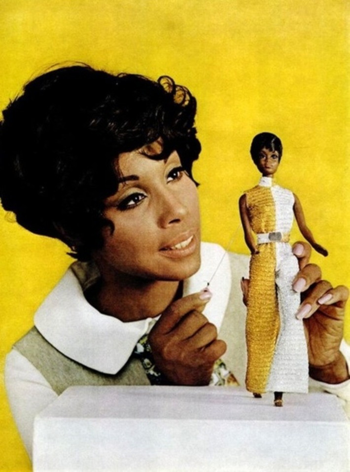 "Diahann Carroll admiring the Barbie doll based on her from her TV show ""Julia"" 