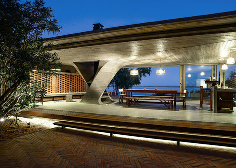 Riverside concrete pavilion by NE-AR houses a fireplace inside a twisted column | Inspired By Design | Scoop.it