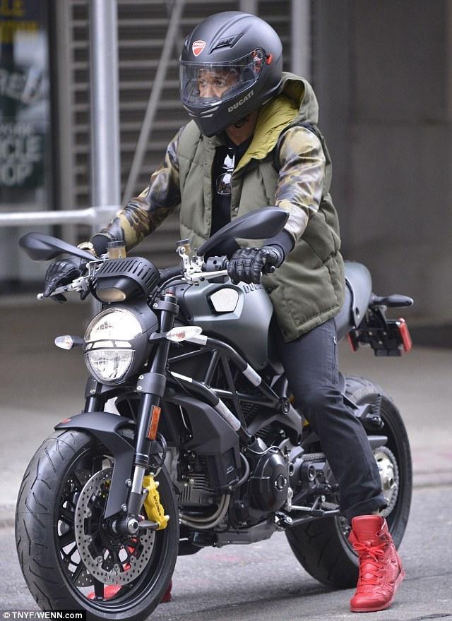 Usher cruises through New York on Ducati Monste...