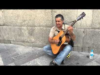 Madrid/Spain - Street Musician with a Guitar - Street I Am   busking   Scoop.it