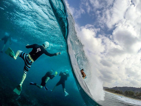 This Amazing Photo Shows A Surfer Above Water And Photographers Below