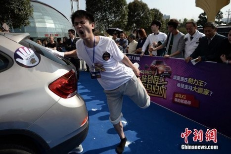 Chinese Contestants Stand on One Leg for Hours on End to Win Brand New BMW   Strange days indeed...   Scoop.it