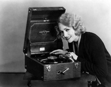 Edwina Booth plays a record on her nifty portable record player | Antiques & Vintage Collectibles | Scoop.it