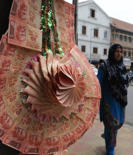 India's central bank to citizens: 'Please stop making garlands out of our money' | Let's Talk Finance | Scoop.it