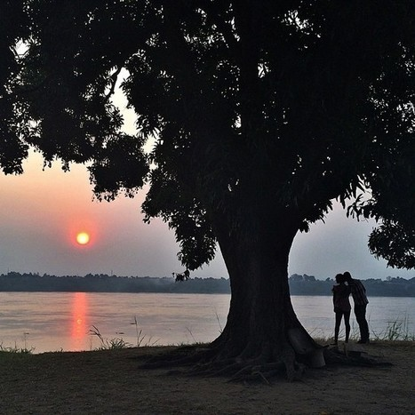 The sun sets over Brazzaville, Republic of Congo, as a couple... | Interesting Photos | Scoop.it