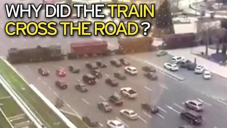 Incredible footage 'shows cargo train crossing busy motorway without warning' | Strange days indeed... | Scoop.it