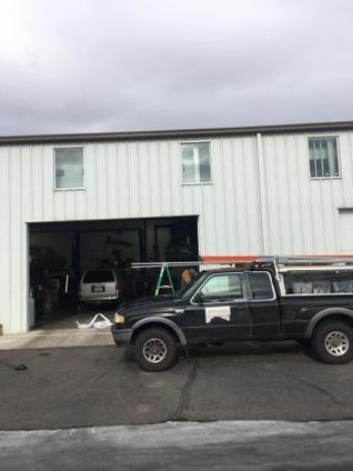 How much do garage door repairs cost by mike s for Garage door service fort collins
