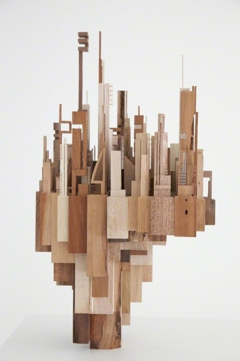 geometric wooden sculptures depict abstract cit