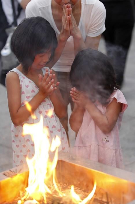 [PHOTOS] Le 66e anniversaire de la bombe d'Hiroshima et des manifestants anti-nucléaires | IB.Times New York | Japon : séisme, tsunami & conséquences | Scoop.it