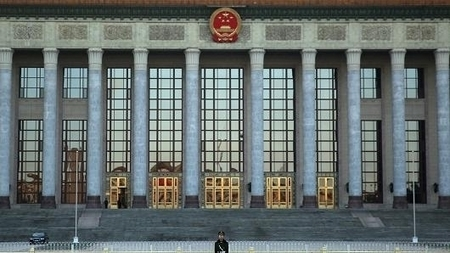A paramilitary policeman guards outside the Great Hall of the People in Beijing, China.| glObserver Global Economics | glObserver Asia | Scoop.it
