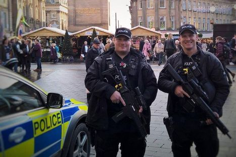 Outrage as armed police pose with children at Christmas market | Policing news | Scoop.it