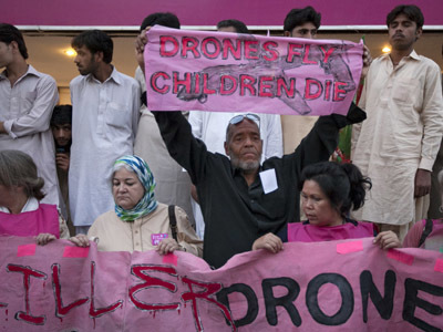 'Stop the drones!' Pakistanis and Western activists march against US strikes — RT | Police Problems and Policy | Scoop.it