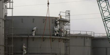 Fukushima : large trou dans lacouverture provisoire duréacteur 1 - le Monde | Gaia news | Scoop.it