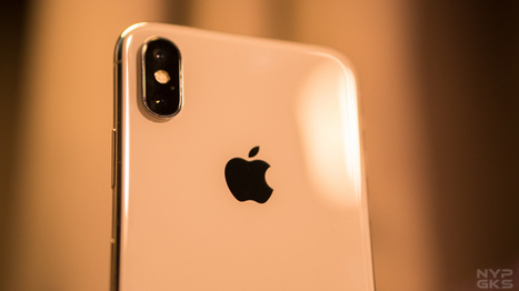 Apple offers flood victims free repair, pick-up