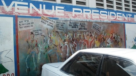 Mural in Port au Prince Haiti representing the people demands to power