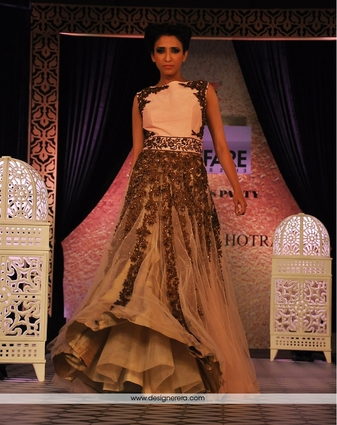 Imaginative Blond Colored Designer Evening Gown...